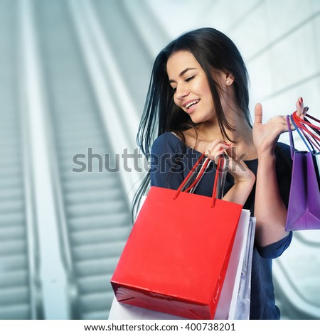 Woman shopping at the mall - stock photo