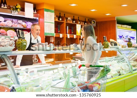 Woman shopping at the supermarket - stock photo