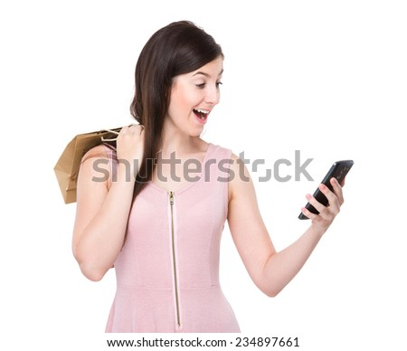 Woman shopping bag and look at mobile phone