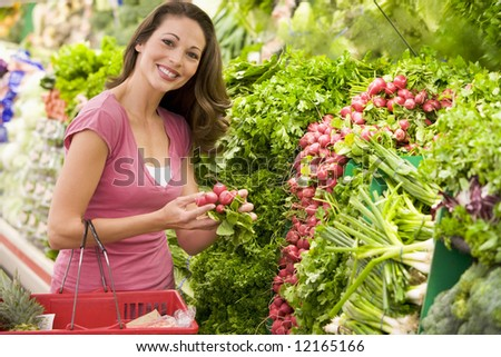 Woman shopping for fresh produce in supermarket - stock photo