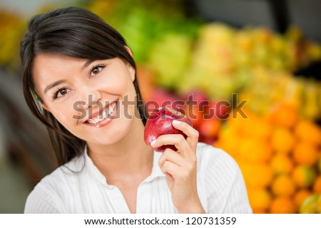 Woman shopping for groceries at the local market - stock photo