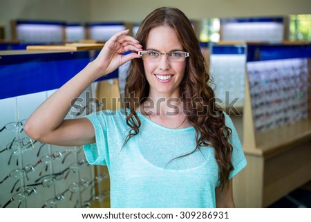 Woman shopping for new glasses at the optometry store - stock photo