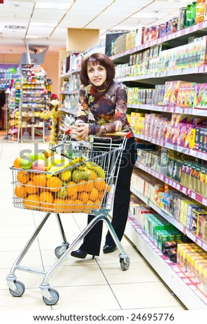 Woman shopping fruits in the supermarket - stock photo