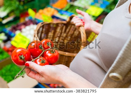Woman shopping groceries on farmers market - stock photo