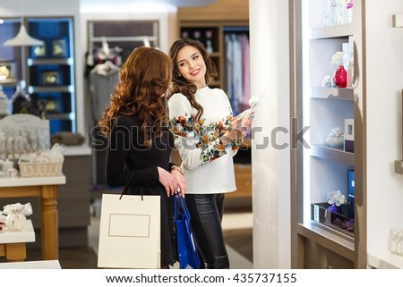 Woman shopping in a boutique. - stock photo