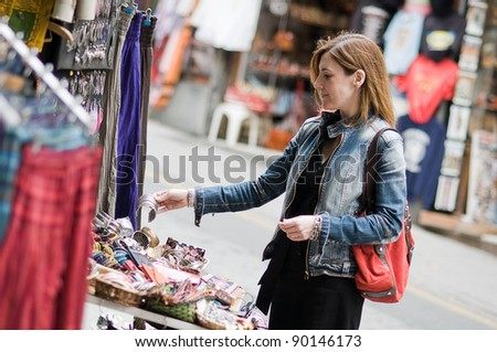Woman shopping in a street market - stock photo