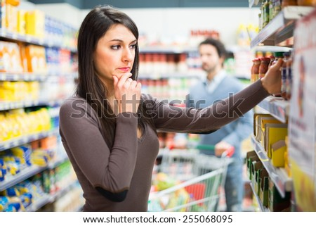 Woman shopping in a supermarket - stock photo