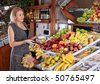 Woman  shopping in grocery supermarket - stock photo