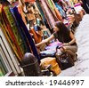 Woman shopping in muslim styled market - stock photo