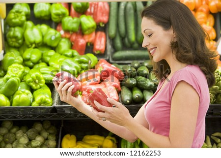 Woman shopping in produce section - stock photo