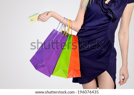 Woman shopping on grey background - stock photo