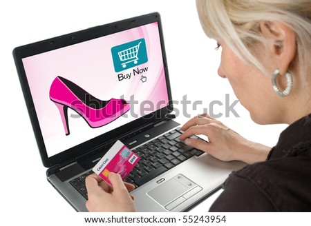 Woman shopping on-line with credit card. Isolated on white background. - stock photo