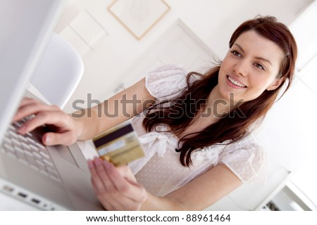 Woman shopping online from home on her laptop computer