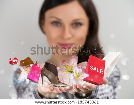 Woman shopping online using her virtual interface - stock photo