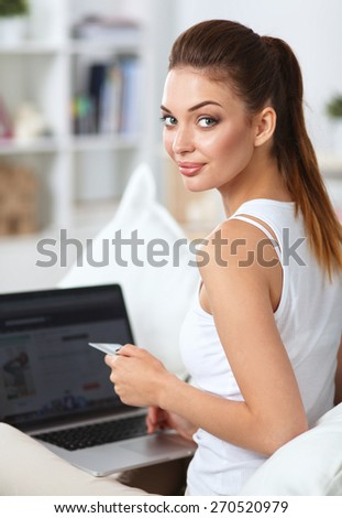 Woman shopping online with credit card and computer.Internet Shopping - stock photo
