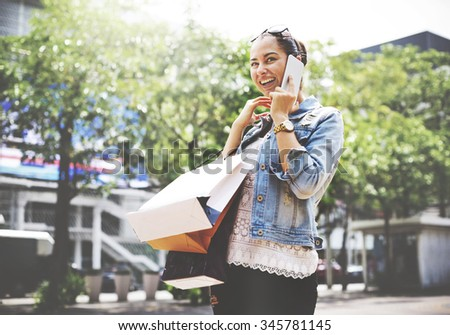 Woman Shopping Outdoor Talking Mobile Phone Concept - stock photo