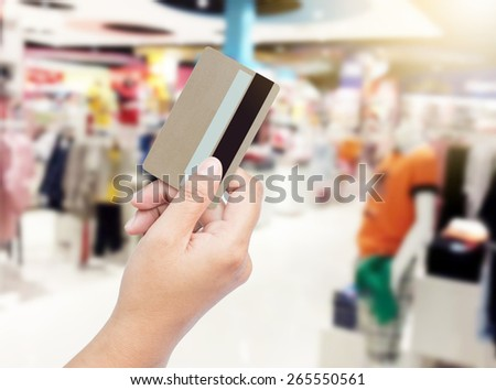 Woman shopping with credit card. - stock photo