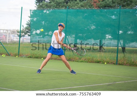 Woman short hair play tennis open court tournament in moving