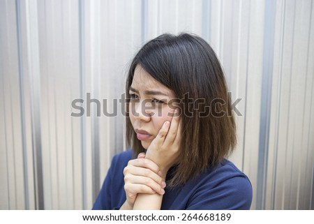 Woman shorthair unhappy with toothache - stock photo