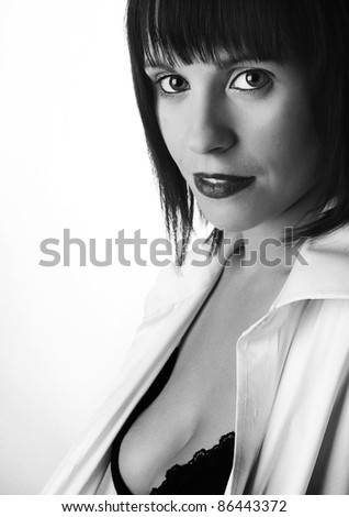 woman shot in the studio wearing black underwear and a mans shirt - stock photo