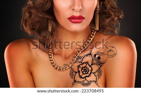 woman shoulder hand with henna tattoo mehendi  - stock photo