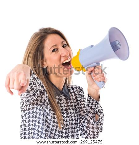 Woman shouting by megaphone - stock photo