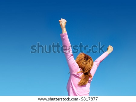 woman shouting happy into the sky - stock photo