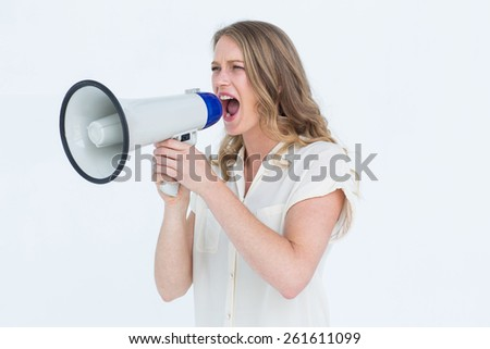 Woman shouting through a loudspeaker on white background