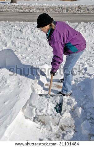 Woman Shoveling Snow - stock photo