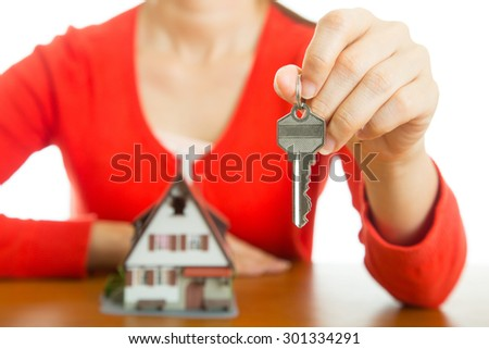 Woman show model house and key for show our real agency property. - stock photo