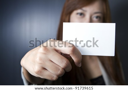 Woman show name card in uniform