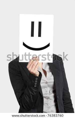 Woman showing a blank paper with a smile in front of her face