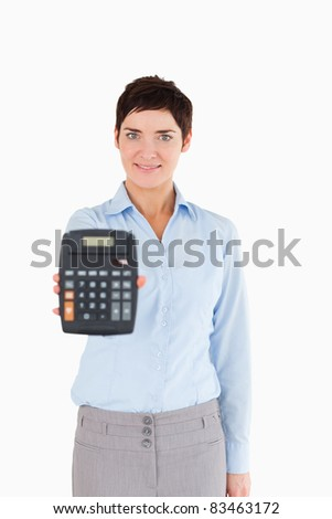 Woman showing a calculator against a white background