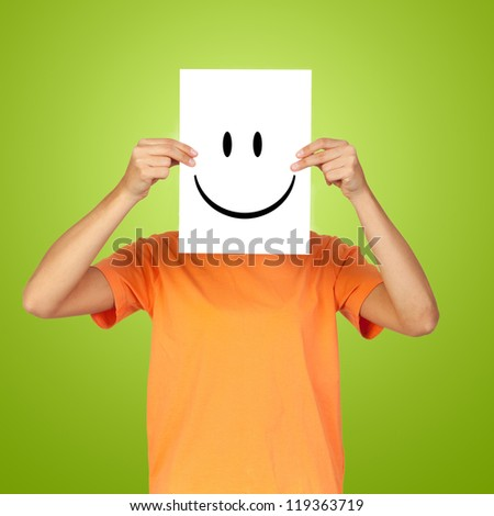 Woman showing a happy emoticon over her face against a green