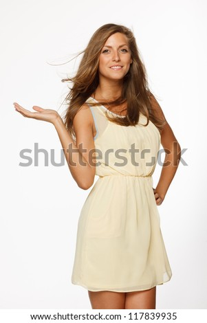 Woman showing a product - empty copy space on the open hand palm, over white background - stock photo