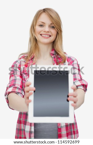 Woman showing a tablet computer against a white background - stock photo