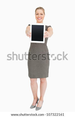 Woman showing a tablet computer against white background - stock photo