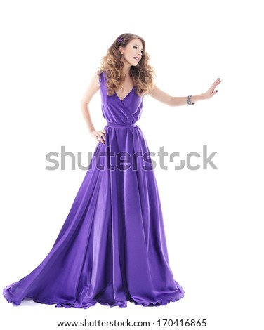 Woman showing advertisement in purple silk dress isolated over white background - stock photo