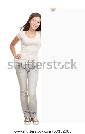Woman showing billboard banner - white and blank with copy space. Caucasian asian model isolated on white background in full length. - stock photo
