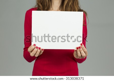 Woman showing board with copy space