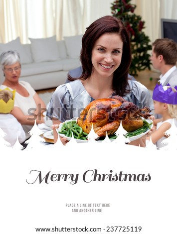 Woman showing Christmas turkey for family dinner against merry christmas - stock photo