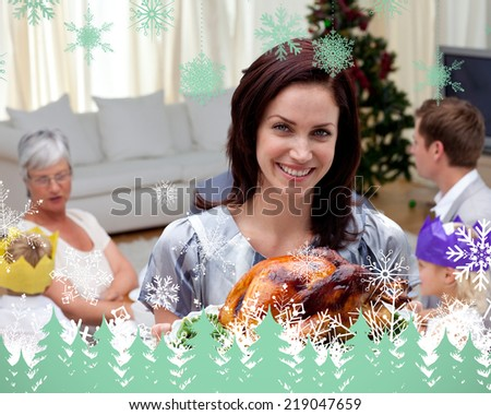 Woman showing Christmas turkey for family dinner against snowflakes and fir trees in green - stock photo