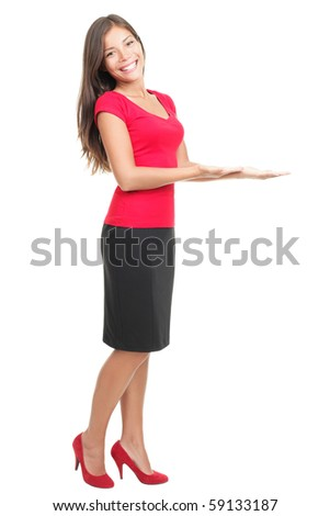 Woman showing / displaying copy space for your product / message. Isolated full body photo of young beautiful mixed Asian / Caucasian female model on white background. - stock photo