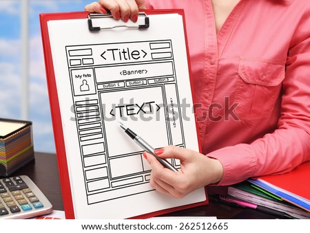 woman showing drawing website on clipboard - stock photo