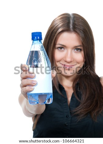 Woman showing drinking water. Healthy lifestyle weight loss concept  isolated on a white background. Focus on hand with bottle of water - stock photo