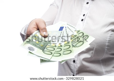Woman showing euro cash isolated on white background - stock photo