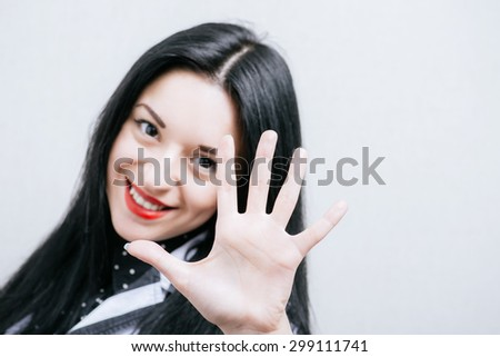Woman showing hand hi hand. On a gray background. - stock photo