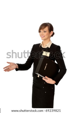 woman showing her badge at the entrance of meeting room and gives hand for a handshake