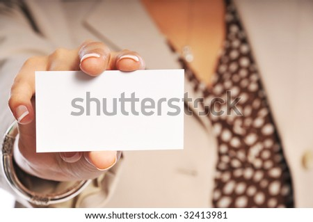 woman showing her business card with focus on the card. - stock photo