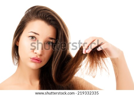 woman showing her fragile hair, white background, copyspace.  - stock photo
